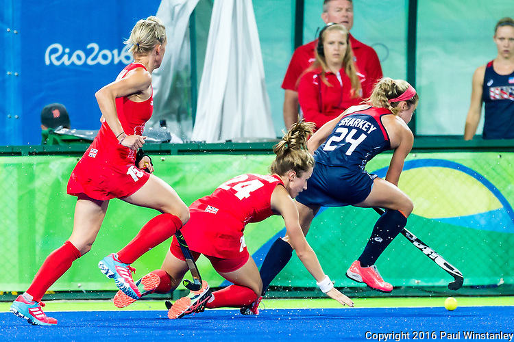 Kathleen Sharkey #24 of United States leaves behind Shona Mccallin #24 of Great Britain and Joie Leigh #14 of Great Britain during Great Britain vs USA in a women's Pool B game at the Rio 2016 Olympics at the Olympic Hockey Centre in Rio de Janeiro, Brazil.