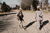 Kabul, Afghanistan<br /> December 1, 2001<br /> <br /> American forces man a check point at a cross roads near the Bagram airport in Kabul. An Afghan confronts  American special forces located at the Bagram airport.