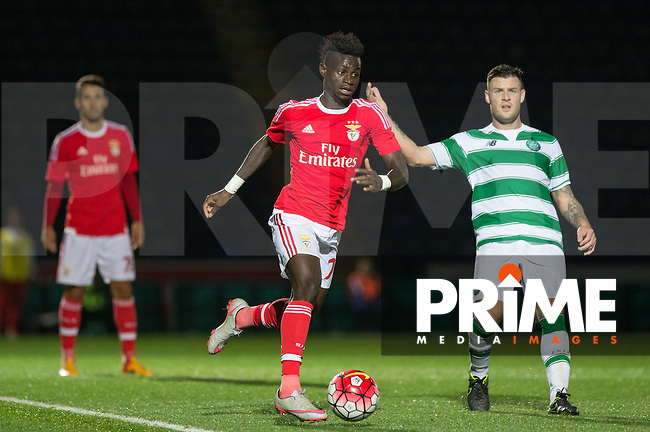 Sanction Silva of SL Benfica B in action as Anthony Stokes of Celtic looks on during the Premier League U21 International Cup match between Celtic U21 and Benfica U21 at Adams Park, High Wycombe, England on 24 September 2015. Photo by Andy Rowland.