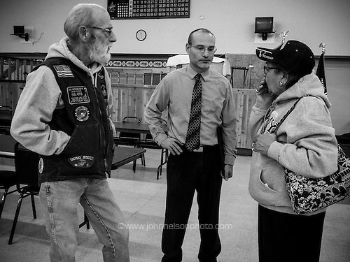 Christopher Anderson, mayor of Lake Station, Ind., chatting with residents at the VFW.
