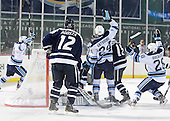 The Black Bears celebrate Mark Anthoine's (Maine - 24) goal. - The University of Maine Black Bears defeated the University of New Hampshire Wildcats 5-4 in overtime on Saturday, January 7, 2012, at Fenway Park in Boston, Massachusetts.