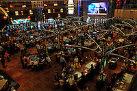 "Gamblers fill the tables in the New Lisboa Casino in Macau, 25th October 2008.  Macau is known simply as ""Vegas"" in China. The former Potuguese colony, now a Chinese Special Administrative Region, attracts millions of Chinese gamblers annually and last year earned more gambling dollars than Las Vegas."