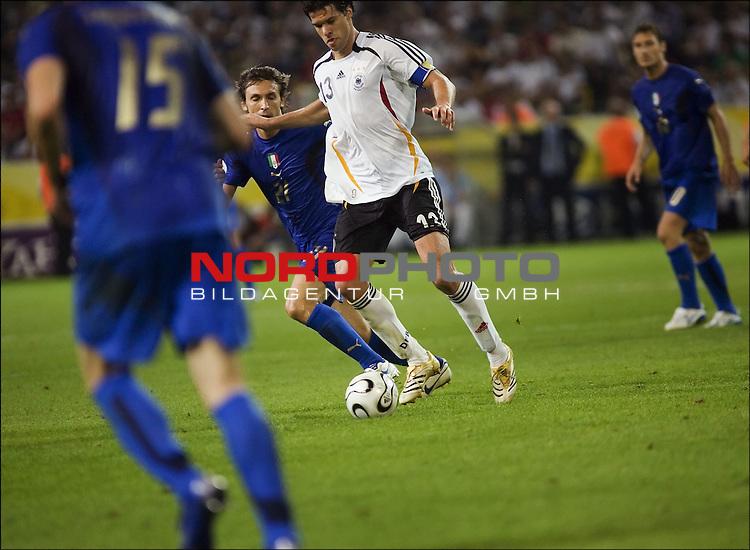 FIFA WM 2006 -  Halbfinale. <br /> Play    #61 (04-Jul) - Deutchland - Italien.<br /> Andrea Pirlo (21) and Michael Ballack.<br /> <br /> Foto &copy; nordphoto