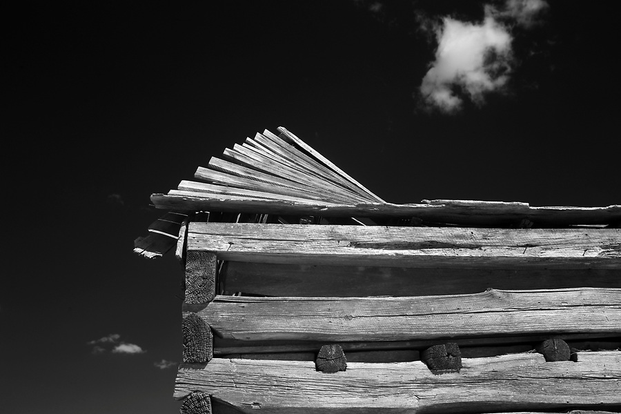 The roof of an old collapsed barn points to a single cloud in the sky in Albemarle County, VA. . Photo/Andrew Shurtleff