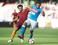 Calcio, Serie A: Napoli vs Roma. Napoli, stadio San Paolo, 15 ottobre. <br /> Napoli's Faouzi Ghoulam, right, is challenged by Roma&rsquo;s Mohamed Salah during the Italian Serie A football match between Napoli and Roma at Naples' San Paolo stadium, 15 October 2016. Roma won 3-1.<br /> UPDATE IMAGES PRESS/Isabella Bonotto