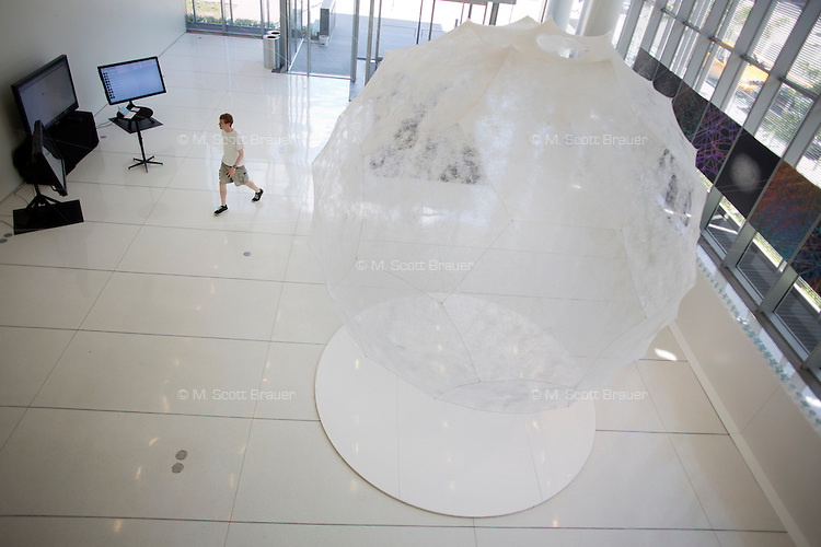People walk through the entrance lobby of the Media Lab building at MIT in Cambridge, Massachusetts, USA.