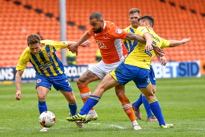 Blackpool's Kyle Vassell battles with Accrington Stanley's Jordan Clark (L)  and Matty Pearson (R)<br /> <br /> Photographer Terry Donnelly/CameraSport<br /> <br /> The EFL Sky Bet League Two - Blackpool v Accrington Stanley - Friday 14th April 2017 - Bloomfield Road - Blackpool<br /> <br /> World Copyright &copy; 2017 CameraSport. All rights reserved. 43 Linden Ave. Countesthorpe. Leicester. England. LE8 5PG - Tel: +44 (0) 116 277 4147 - admin@camerasport.com - www.camerasport.com