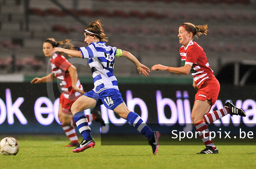20130913 - ANTWERPEN , BELGIUM : Antwerp Lisa Korevaar (right) pictured defending on Gent's Elke Van De Sompel (right) during the female soccer match between Royal Antwerp FC Vrouwen / Ladies and K AA Gent Ladies at the BOSUIL STADIUM , of the fourth matchday in the BENELEAGUE competition. Friday 13 September 2013. PHOTO DAVID CATRY