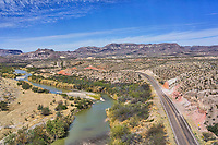 Another aerial view of the Big Bend State Park as the Rio Grande flows through the desert and mountains along the river road as it follows the river in this landscape view.