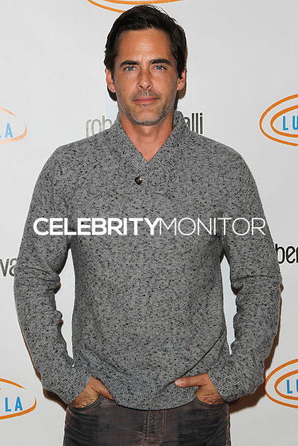BEVERLY HILLS, CA, USA - NOVEMBER 21: Adam Kaufman arrives at the 12th Annual Lupus LA Hollywood Bag Ladies Luncheon held at The Beverly Hilton Hotel on November 21, 2014 in Beverly Hills, California, United States. (Photo by Celebrity Monitor)