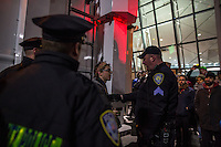 NEW YORK, NY - JANUARY 28: Police talks with a man during a demonstration against the Muslim immigration ban at John F. Kennedy International Airport on January 28, 2017 in New York City. President Trump signed an executive order to suspend refugee arrivals and people with valid visa from Iran, Iraq, Libya, Somalia, Sudan, Syria and Yemen. Photo by VIEWpress/Maite H. Mateo.