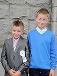 Cian Coleman who received First Holy Communion in St. Cianan's church Duleek pictured with brother Glen who was confirmed at the same church this week. Photo: Colin Bell/pressphotos.ie