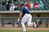 Left fielder Tim Tebow (15) of the Columbia Fireflies runs out a hit in the ninth inning in a game against the Lexington Legends on Sunday, April 23, 2017, at Spirit Communications Park in Columbia, South Carolina. Lexington won, 4-2. (Tom Priddy/Four Seam Images)