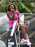 NEW YORK - AUGUST 26:  Serena Williams sits in the Judges seat at the Nike tennis court challenging fans to return a pro serve on August 26, 2009 in New York City.  (Photo by Donald Bowers)