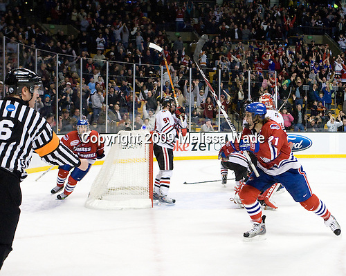 Paul Worthington (UMass-Lowell - 22), Ben Holmstrom (UMass-Lowell - 21) - The University of Massachusetts-Lowell River Hawks defeated the Northeastern University Huskies 3-2 (OT) in their Hockey East Semi-Final match on Friday, March 20, 2009, at the TD BankNorth Garden in Boston, Massachusetts.