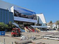 Workers preparing the area for the Cannes Film Festival, Palais des Festivals et des Congres, Cannes, France.