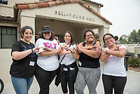 Sisters of Sigma Lambda Gamma stand-by to help the class of 2021 move into Bell-Young — with Hailey Gil, Maria Hernandez, Vanessa Garcia and Rosa Aizakijani Pleasant. Incoming first-years and their families are welcomed by O-Team members and the community at the start of Occidental College's Fall Orientation for the class of 2021, Aug. 24, 2017.<br /> (Photo by Marc Campos, Occidental College Photographer)