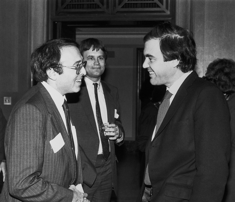 Rep. Howard Wolpe, D-Mich., talking with party members. (Photo by CQ Roll Call)