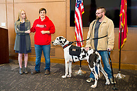 Lance McElhenney, right, a veteran of Operation Iraqi Freedom who received the Purple Heart, was presented with his new mobility service dog during a ceremony this week at MSU&rsquo;s G.V. &ldquo;Sonny&rdquo; Montgomery Center for America&rsquo;s Veterans at Nusz Hall. Making the presentation were representatives of the Shane Flynn family and the SD Gunner Fund. The late Shane Flynn formerly owned the service dog, a Great Dane also named &ldquo;Flynn.&rdquo; His daughter Rachel Flynn, left, wanted his service dog to go to a veteran in need of such an animal. Britnee Kinard, second from left, is president and founder of the SD Gunner Fund, an organization that assists veterans and disabled children with the financial expense of owning much needed service animals.<br />