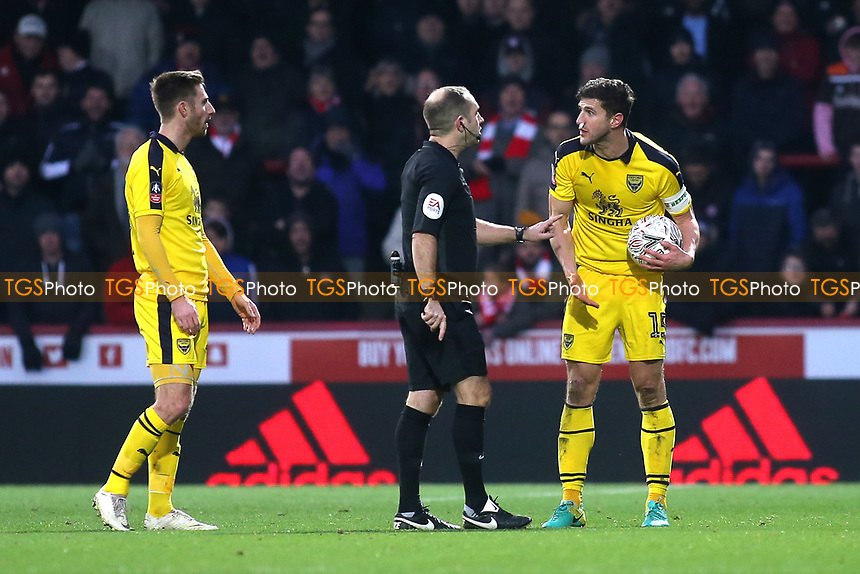 Oxford United captain, John Mousinho has a word with referee, Jeremy Simpson, after he gives a decision against him during Brentford vs Oxford United, Emirates FA Cup Football at Griffin Park on 5th January 2019