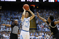 CHAPEL HILL, NC - MARCH 03: Cole Anthony #2 of the University of North Carolina is guarded by Brandon Childress #0 of Wake Forest University during a game between Wake Forest and North Carolina at Dean E. Smith Center on March 03, 2020 in Chapel Hill, North Carolina.