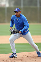 Carlos Marmol #49 of the Chicago Cubs participates in pitchers fielding practice during spring training workouts at the Cubs complex on February 19, 2011  in Mesa, Arizona. .Photo by Bill Mitchell / Four Seam Images.