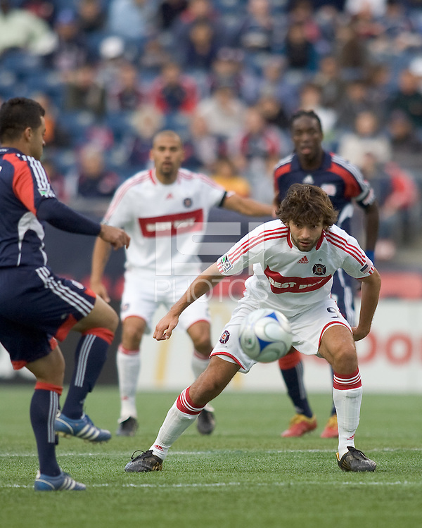 Chicago Fire midfielder Baggio Husidic (9) focuses on ball as New England Revolution midfielder Mauricio Castro (16) receives a pass. The New England Revolution out scored the Chicago Fire, 2-1, in Game 1 of the Eastern Conference Semifinal Series at Gillette Stadium on November 1, 2009.