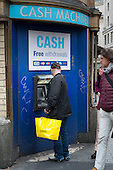 Shopper using a cash machine in Oxford Street, London.