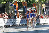 03 SEP 2006 - LAUSANNE, SUI - Will Clarke (GBR) makes a break on his way to winning the U23 Mens ITU World Triathlon Championship title (PHOTO (C) NIGEL FARROW)