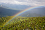 Rainbow after a rainstorm during the summer months along the Moat Mountain Trail near South Moat Mountain in Albany, New Hampshire USA