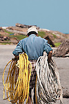 hard working fisherman with ropes  KOVALAM beach india
