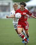 Marinette Pichon (11) shields the ball from Nancy Augustyniak (25) at Villanova Stadium in Villanova, PA on 8/2/03 during a game between the Philadelphia Charge and Atlanta Beat. The Charge won the game 3-0.