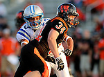 SIOUX FALLS, SD - SEPTEMBER 19: Jacob Skogstad #34 from Washington gets a step past Isaiah Shevlin #53 from Rapid City Stevens in the second quarter of their game Friday night at Howard Wood Field.  (Photo by Dave Eggen/Inertia)