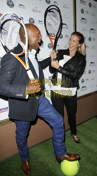 Mark Smith &amp; Gemma Atkinson<br /> attended the Slazenger Wimbledon Party, Whisky Mist bar &amp; nightclub, Hertford St., London, England, UK, 27th June 2013.<br /> full length tennis racquets funny black leather jacket jeans grey gray blazer white top trousers <br /> CAP/CAN<br /> &copy;Can Nguyen/Capital Pictures