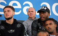 (L-R) Swansea player Matt Grimes, assistant coach Nigel Gibbs, players Leroy Fer, Wayne Routledge watch the game during the Swansea Legends v Manchester United Legends at The Liberty Stadium, Swansea, Wales, UK. Wednesday 09 August 2017