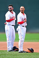 Portland Sea Dogs infielders Deven Marrero #18, and Mookie Betts #7  prior to a game versus the Trenton Thunder at Hadlock Field in Portland, Maine on May 17, 2014. (Ken Babbitt/Four Seam Images)