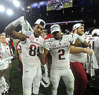 NWA Media/Michael Woods --12/29/2014-- w @NWAMICHAELW...University of Arkansas players Demetrius Wilsom (85) and D.J. Dean celebrate their 31-7 win over the University if Texas at the Texas Bowl Monday night at  NRG Stadium in Houston.