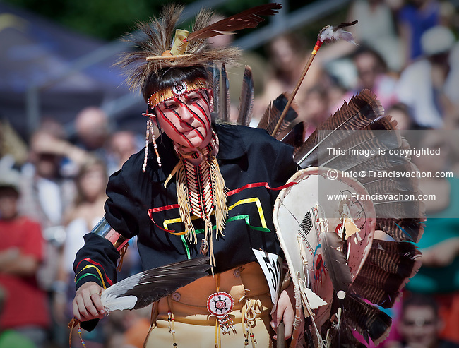 Michael Gros-Louis from Wendake wearing Huron-Wendat traditional dresses and paint takes part into the dance contest of the Wendake Pow-Wow July 1, 2012. The Wyandot (also called Huron) are indigenous peoples of North America, known in their native language of the Iroquoian family as the Wendat.