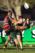 Shirley Halasima gets his boot to the ball as Gregory Christie makes a pass. Counties Manukau Premier Club Rugby game between Pukekohe and Papakura, played at Colin Lawrie Fields Pukekohe on Saturday June 9th 2018. Pukekohe won the game 37 - 22 after leading 15 - 10 at halftime. <br /> Photo by Richard Spranger.
