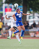 In a National Women's Soccer League Elite (NWSL) match, Portland Thorns FC defeated the Boston Breakers, 2-1, at Dilboy Stadium on July 21, 2013.  Boston Breakers forward Sydney Leroux (2) and Portland Thorns FC defender Kathryn Williamson (5) compete for a head ball.