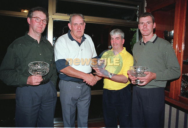 Aiden Hanratty chairman Stabannon Parenells presenting the Stabannon Parenells Golf classic winning team of Fergus Rennicks, Paul Heavey, Paul Rennicks and (Missing) Michael Connell with there crystal...Picture Fran Caffrey /Newsfile.Mid-Louth