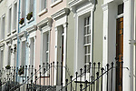 Pastel coloured painted houses in Notting Hill London England