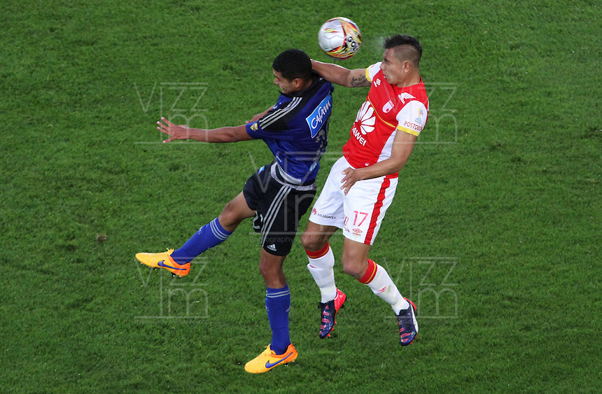 BOGOTA - COLOMBIA - 6-09-2015:*Juan Roa jugador de Independiente Santa Fe  disputa el balon con Steven Vega  de Millonarios     durante partido  por la fecha 10 de la Liga Aguila II 2015 jugado en el estadio Nemesio Camacho El Campin. / Juan Roa player of Independiente Santa Fe   fights the ball against Steven Vega of Millonarios   during a match for the tenth  date of the Liga Aguila II 2015 played at Nemesio Camacho El Campin stadium in Bogota  city. Photo: VizzorImage / Felipe Caicedo / Staff.