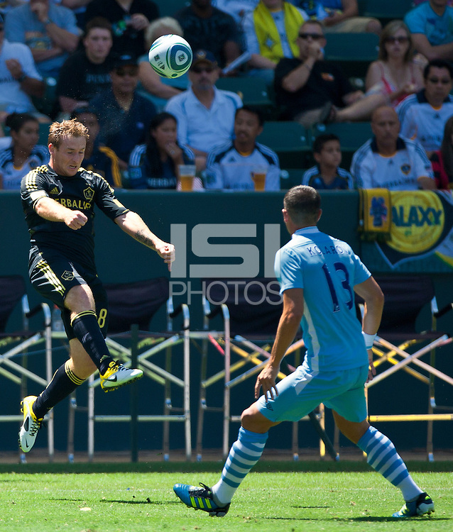 CARSON, CA – July 24, 2011: Chris Birchall (8) of LA Galaxy during the match between LA Galaxy and Manchester City FC at the Home Depot Center in Carson, California. Final score Manchester City FC 1 and LA Galaxy 1. Manchester City wins shoot out 7, LA Galaxy 6.