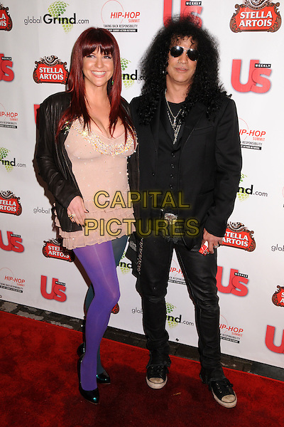 PERLA FERRAR & SLASH.2009 Grammy Awards Post Party at a Private Residence, Beverly Hills, California, USA..February 8th, 2009.full length married husband wife black jacket beige pink ruffled ruffles top sunglasses shades marlboro cigarettes purple tights leather jeans denim .CAP/ADM/BP.©Byron Purvis/AdMedia/Capital Pictures.