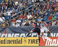 New England Revolution defender Chris Tierney (8) and Toronto FC midfielder Matias Laba (20) battle for head ball.  In a Major League Soccer (MLS) match, Toronto FC (white/red) defeated the New England Revolution (blue), 1-0, at Gillette Stadium on August 4, 2013.