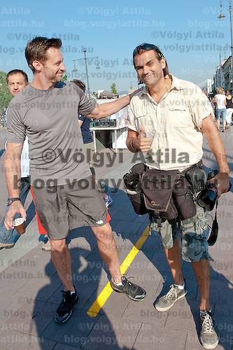 Hollywood actor Hugh Jackman (L) poses with Ferenc Isza (R) during a commercial shooting for Lipton Ice Tea in Budapest, Hungary on September 02, 2011. ATTILA VOLGYI