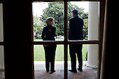 Washington, DC - August 18, 2009 -- National Security Advisor General Jim Jones (United States Marine Corps) and U.S. Secretary of State Hillary Rodham Clinton chat outside of the Oval Office after a meeting with Egyptian President Mubarak, August 18, 2009..Mandatory Credit: Pete Souza - White House via CNP
