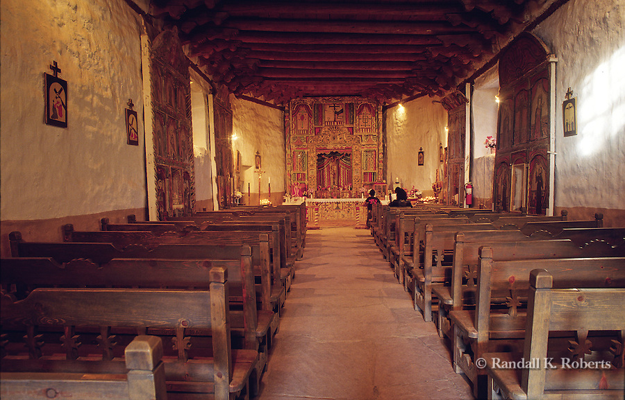 Interior of Santuario de Chimayo, New Mexico. The dirt from an anteroom in the church is said to have miraculous healing powers.