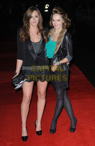 HANNAH TOINTON & KARA TOINTON.attending the European Premiere of 'Harry Brown' at the Odeon Leicester Square, London, England, UK, November 10th 2009..full length sisters family black tux tuxedo jacket clutch bag silver cuff bracelet mini dress green top fur lapel collar waist belt skirt platform shoes heels tights bracelets scallop hem.CAP/CAS.©Bob Cass/Capital Pictures.